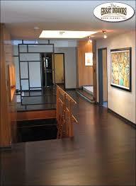 beautiful hardwood floor in indianapolis hallway with descending stairway
