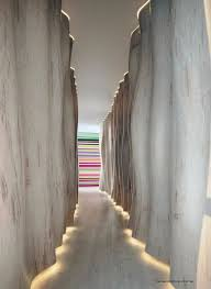 cool hallway lighting. wavy and textured wall that imitates look of a tree with cleaver lighting cool hallway l
