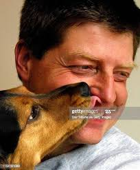 Bob Trester gets a kiss and a lick of approval from Fergus the dog in ...