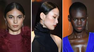 headshots of three models walking the cushnie fw 2019 runway all wearing monochromatic terracottacolored makeup on