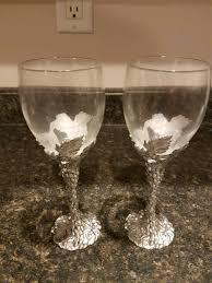 description pair of seagull pewter wine glasses