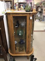 desirable original finish mahogany curved glass china cabinet with paw feet door and both side glasses are curved the sectioned back has mirrors in