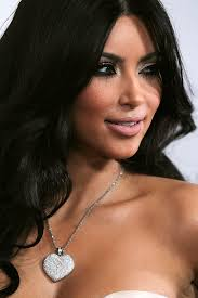 kim kardashian add a dash of bling to her look with a diamond heart pendant neckalce