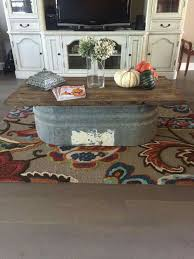 crazy coffee tables this would be crazy easy to make galvanized trough made into a