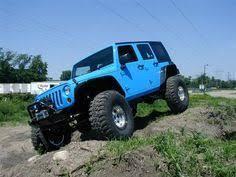 light blue four door jeep
