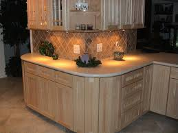 natural maple cabinetry and linen corian countertop
