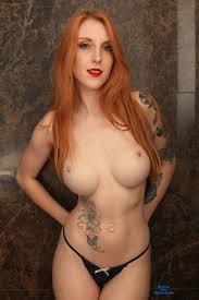 Nude big tits red head