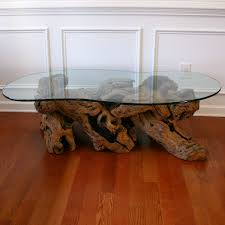 old crate and barrel driftwood coffee table with glass top for living room furniture decoration and hardwood floor tiles beside white wooden cabinet