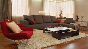 Modern Apartment Living Room Design With Red Armless Accent Chair