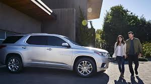 2018 chevrolet traverse high country with couple in front of garage at home