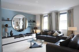 Interior Designs For Living Room With Brown Furniture Living Room Oversized Round Wall Mirror With Floating Shelves