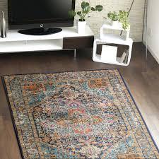 orange and blue area rug hillsby artemis