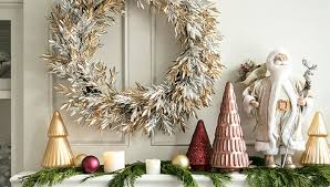 A Mantel Decorated with White and Gold Christmas Decorations, Including  Warm Accent Colors.