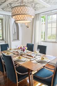 flying pig chandelier dining room transitional with upholstered dining chairs clear shade