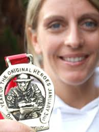 Second to none: tough girl Lisa Foley with her winner's medal. - 1183280