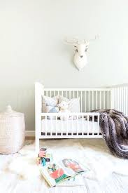 faux fur rug nursery design welcoming gray and white nursery features a pink woven hamper placed faux fur rug nursery