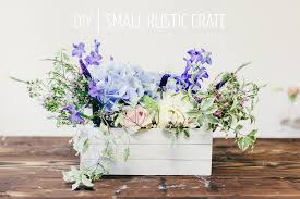 rustic wedding table centrepiece diy tutorial showing you how to create a fl centrepiece using a wooden crate