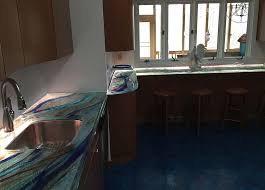 contact us to learn more about glass countertops and how we can implement them in your home design
