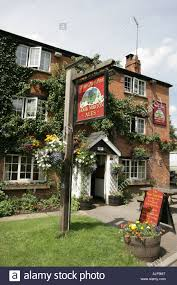 a summers day out side the pear tree pub at hook norton oxfordshire stock image