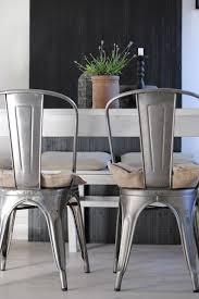 tolix chairs with a black door from biskop s garden