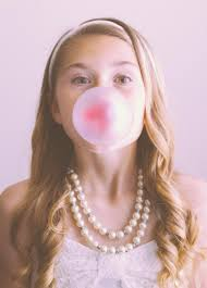 Girl blowing bubble Bubble gum girl portrait Trinity Katy TX.