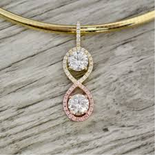 two round brilliants in a pre set halo infinity pendant in rose and yellow