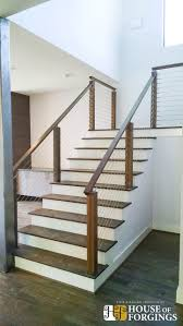This staircase uses high quality marine grade stainless steel cable rail to  create a unique modern