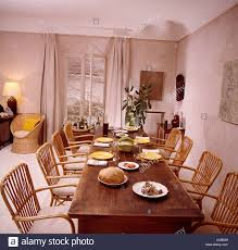 french country dining rooms. Cane Chairs At Long Antique Table In French Country Dining Room With Beige Curtains Windows Rooms