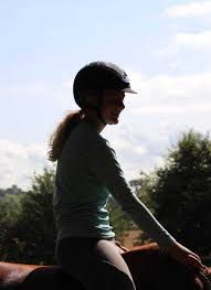 Girl uses sharp spurs on boy