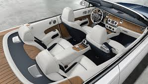 This Teak Clad Rolls Royce Dawn Is Fully Customized To Resemble A