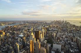 new york city skyline looking south towards lower manhattan at sunset