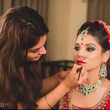 consult with your professional makeup artist in advance about the looks which will go with the