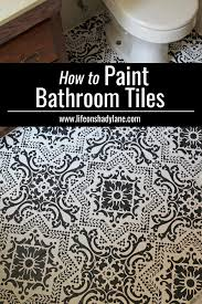 diy how to easily paint your tile floor for a budget friendly modern update black and white stencils r70 stencils