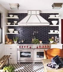 gorgeous kitchen with navy blue subway tiles