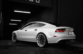 audi a7 2014 custom. customized audi a7 with a complete matte pearl white vinyl wrap gloss black roof and accents smoked lights painted red brake calipers color matched 2014 custom