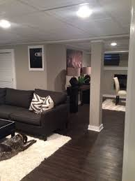 basement drop ceiling. basement remodel - love the dark floors different ceiling tiles are nice. and framed drop