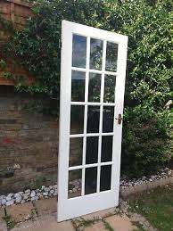 white painted solid internal wooden door with 15 glass panels