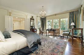 Master bedroom in luxury home with sitting room