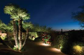 beautiful gardens shouldn t hide after dark and they won t with professional landscape lighting