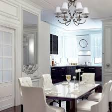 interior view modern 6 arm ceiling chandelier in chrome with white fabric shades
