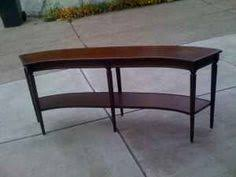 Interesting curved sofa table for those curved couches.