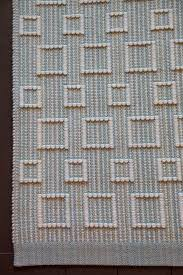 small wool area rug hand woven geometric blue greens cream