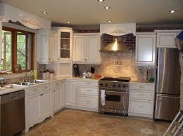 kitchen featuring white finish varnished wooden kichen cabinet glass door kitchen cabinets brick stone island
