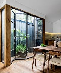 accordion glass doors with screen. interior design ideas: beautiful home glass door, verandah, kitchen by adrian amore architects, table, wood furniture accordion doors with screen s