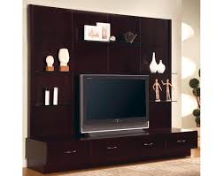 trendy entertainment center with low flat screen tv stand and floating glass decorative shelves plus four