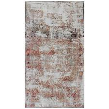 distressed and rustic persian rug with red and navy blue accents for