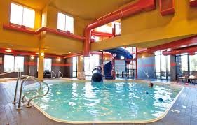indoor pool with waterslide. Keep The Kids Entertained For Hours By Looking One Of Best Hotels In Kelowna Indoor Pool With Waterslide