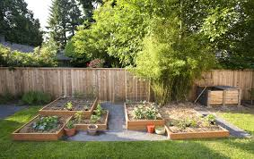 small square foot backyard vegetable garden ideas with wood raised bed and wire trellis wooden fence and bamboo plants plus gravels and green grass ideas