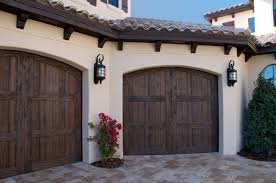 faux wood garage doors. Plain Wood Our Faux Wood Carriage House Style Garage Doors Add Curb Appeal To This  Florida Mediterranean And Faux Wood Garage Doors W
