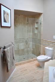 wonderful artwork portray over polished nickel towel bar and frameless sliding glass shower door in small